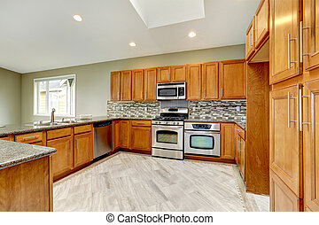 Luxury kitchen room with bright brown cabinets