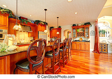 Luxury kitchen room with rich carved wood stools