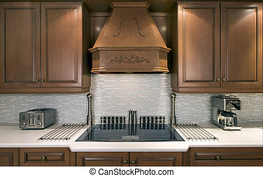 Luxury kitchen with cooktop - a section of an upscale...