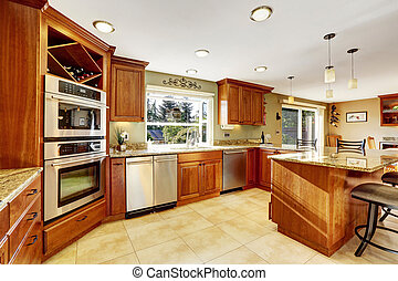 Luxury kitchen with tile floor and stained cabinets