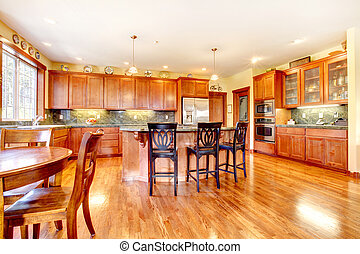 Luxury large cherry wood kitchen with green and yellow.
