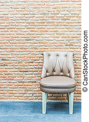 Luxury leather chair on brick wall background
