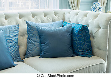 luxury living room interior with blue pattern pillows on sofa