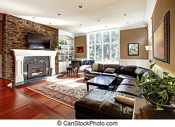 Luxury living room with stobe fireplace and leather sofas.