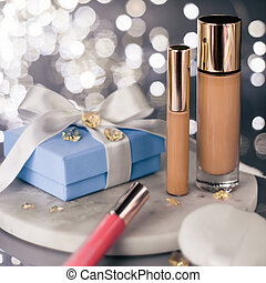 luxury make-up products as a gift - beauty, cosmetics and makeup styled concept