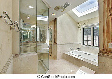 Luxury master bath with skylight and glass shower