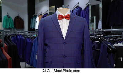 Luxury men fashion suit displaying on mannequin in store