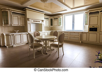 Luxury modern fitted kitchen interior. Kitchen in luxury home with beige cabinetry. Table and chairs