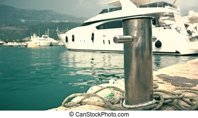Luxury motor yacht behind mooring bollard at the Adriatic...