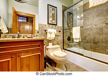 Luxury mountain cabin home bathroom with shower, tub.