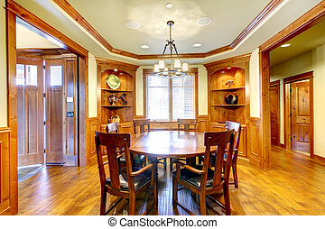 Luxury mountain home diining room with wood molding.