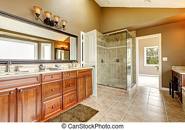 Luxury new large bathroom interior with brown tiles.
