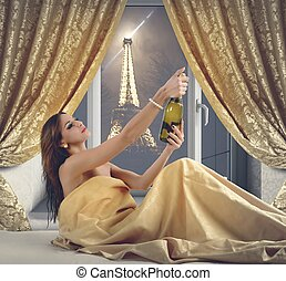 Luxury New Year Eve - Woman celebrating New Year Eve in...