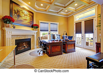 Luxury office room interior with coffered ceiling, fireplace...