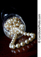 Luxury - Pearls flowing out of champagne glass