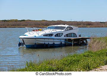 Luxury pleasure boat moored at the pier