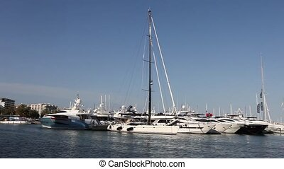 Luxury pleasure boats in a marina - Row of motorised luxury...