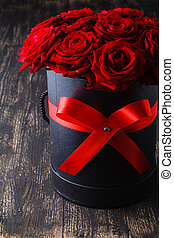 Luxury red roses on a wood background