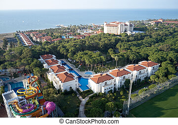 Luxury resort hotel with a swimming pools, top view.
