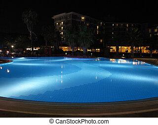 Luxury resort with beautiful pool and illumination night view
