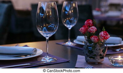 luxury restaurant table layout with red roses for a romantic dinner