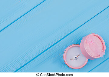 Luxury ring in a pink round box.