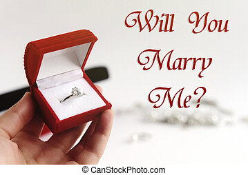 luxury ring in hand, will you marry me text, greeting card concept