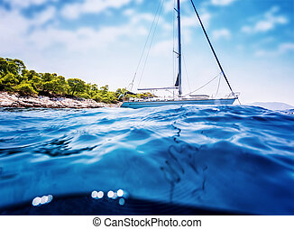 Luxury sailboat near tropical island