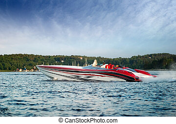 Luxury Speedboat - A very large speedboat crusing on a lake.