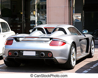 MONACO - JULY 07: Parked luxury car on July 07 2008 in Monte Carlo, Monaco. Monaco has one of the highest standards of living in the world. Material symbol of wealth such as expensive cars are visible everywhere.