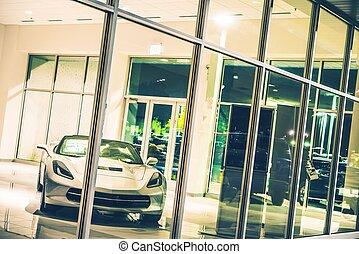 Luxury Sporty Car For Sale Inside Dealer Showroom at Night....