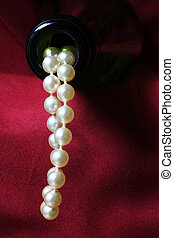 Luxury concept with pearls flowing out of a champagne bottle...