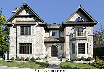 Luxury stone home with balcony