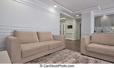 Luxury studio apartment with kitchen and living room interior, track camera movement