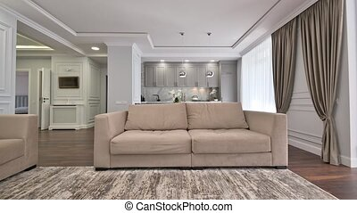 Luxury studio apartment with kitchen and living room interior with dining table and sofa, track camera movement