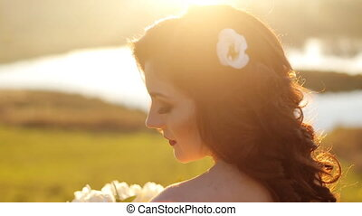 luxury stylish young bride on the background autumn sunny  forest shot in slow motion  close up