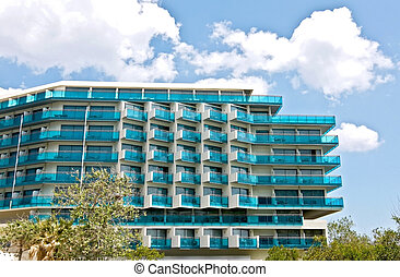 Luxury summer vacation hotel with blue windows at Rhodes island in Greece