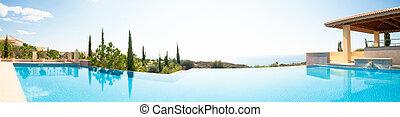 Luxury swimming pool. Panoramic image - Sea view luxury...