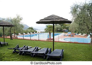 Luxury swimmingpool - luxury swimmingpool with parasols...