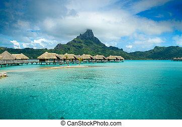 Luxury thatched roof bungalow resort on Bora Bora - Luxury...