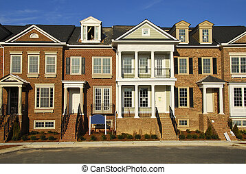 new luxury townhomes under construction in gated community