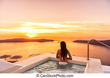 Luxury travel Santorini vacation woman swimming in hotel ...