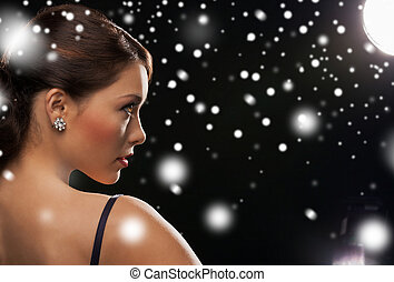 woman in evening dress wearing diamond earrings - luxury,...