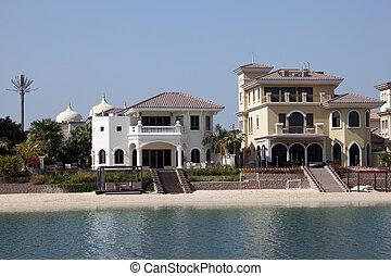 Luxury waterfront buildings at the Palm Jumeirah, Dubai, United Arab Emirates