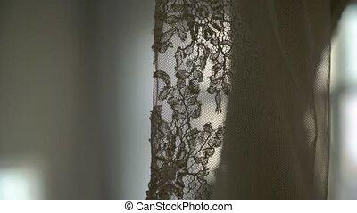 Luxury wedding dress hanging in bedroom. Silhouette of...