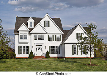 Luxury white home in suburbs with orange brick steps