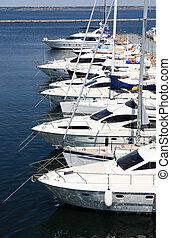 luxury white yachts at berth
