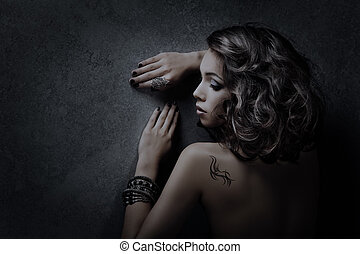 Luxury woman hairstyle portrait over dark background