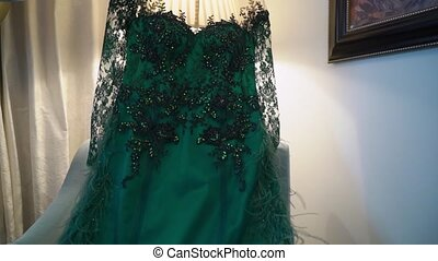 Luxury woman's green dress and shoes