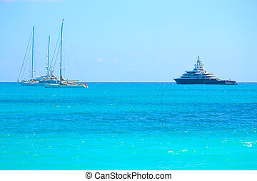 Luxury Yacht and Sailboat